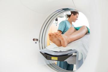 Nurse Looking Patient Undergoing CT Scan