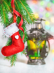 Christmas red sock on fir branch and lantern