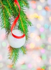 Christmas ball and red ribbon