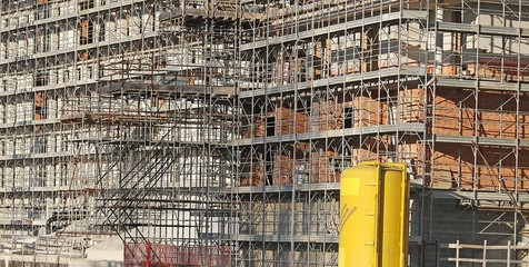 immense construction site during construction of a housing build