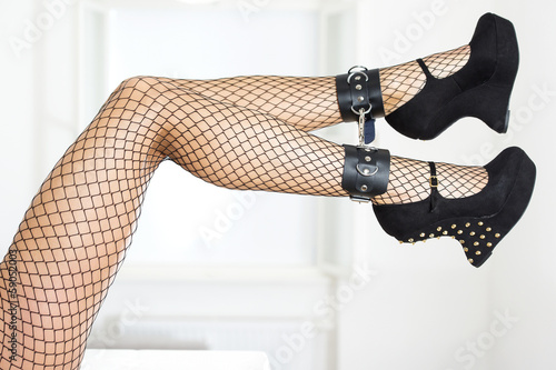 Legs in fishnet stockings and fetish high heels