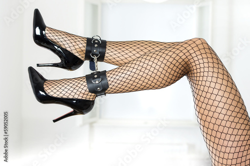 sexy legs fishnet stockings and ankle cuffs