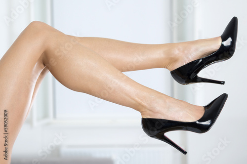 Long and sexy female legs in elegant high heels shoes