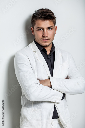 young man wearing white suit