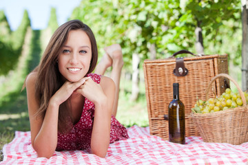 Happy young woman having a picnic