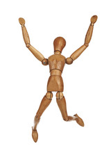 Happy wooden dummy in jump action isolated on white background