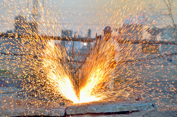 worker cut metal using blowtorch