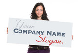 Casual brunette holding a blank signboard