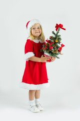 Sweet girl in a red Christmas costume