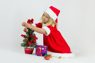 Girl in a red Christmas costume
