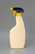 Beige detergent plastic spray bottle Isolated on gray