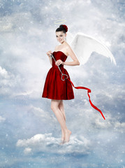 Beautiful brunette woman as cupid with key to heart