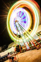 Thailand Ferris wheel night motion blur colourful