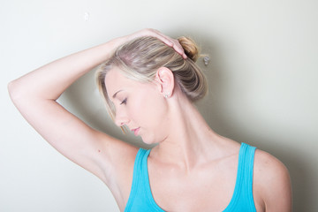 Young Female using hands neck exercises