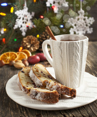 Cup of tea and pieces of Christmas stollen