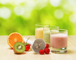 Fruit smoothie on wooden table on narural background
