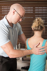 Chiropractor massage the Female patient spine back