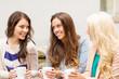 three beautiful girls drinking coffee in cafe