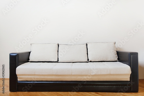 couch in white room