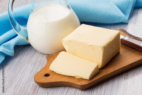 Fresh butter on wooden board.