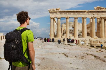 tourist looking at Parthenon, Acropolis ruin, Athens, Greece