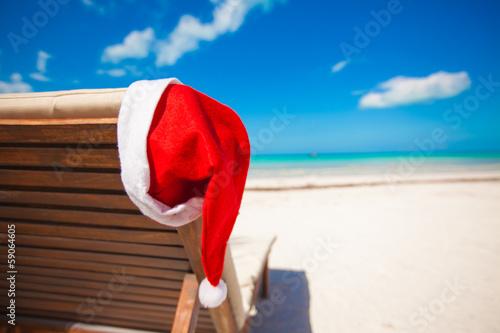Papiers peints Ile Santa hat on chair longue at tropical caribbean beach