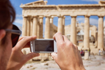 tourist taking photo of Parthenon, Acropolis, Greece