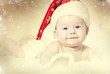 Portrait of a baby girl with Santa hat