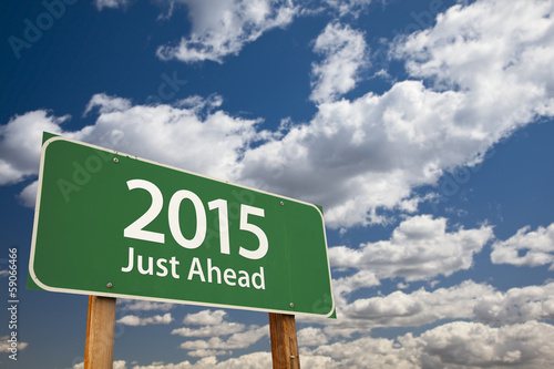 2015 Just Ahead Green Road Sign Over Clouds and Sky