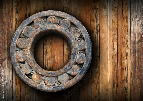 huge rusty ball bearing hung on the wall