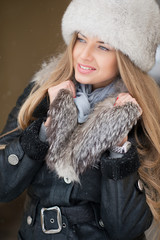 Beautiful winter portrait of young woman in the winter