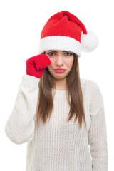 Sad young woman with Santa hat