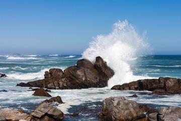 Waves crashing against boulders