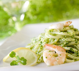 linguine pasta with fresh shrimp and pesto sauce.