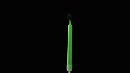 Birthday candle being blown