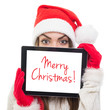 Happy young woman with Santa hat wishes Merry Christmas