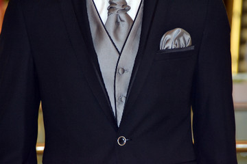 Man with black and gray suit