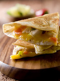 Closeup of a chicken and vegetable quesadilla.