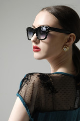 Young woman wearing the modern sunglasses