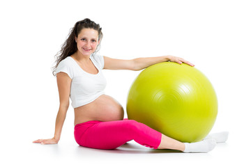 Pregnant woman excercises with fitness ball