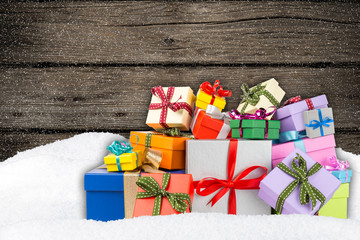 colorful gift boxes in snow