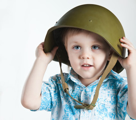 Boy with army helmet isolated on white