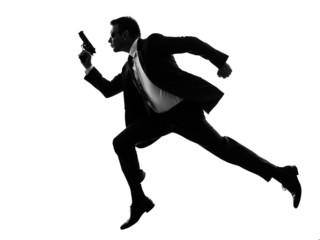 man with handgun running silhouette