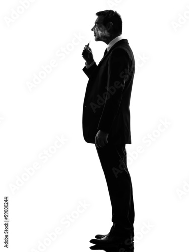 business man smoking electronic e-cigarette silhouette