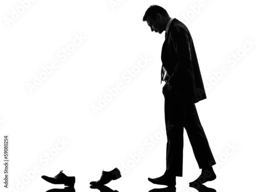 business man walking behind his shoes  clothes  silhouette