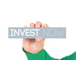 woman holding a label with invest now
