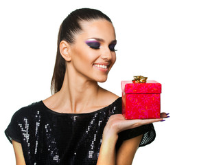 Beautiful woman holding a red present over a white background
