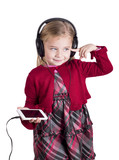 Little blonde girl smiling listening to music on smart phone
