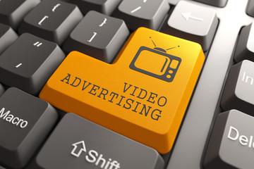 Video Advertising on Orange Keyboard Button.