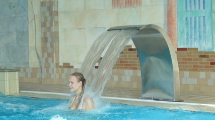 Girl playing in a swimming pool